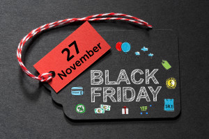 Black Friday November 27 text on a black tag with a red and white twine